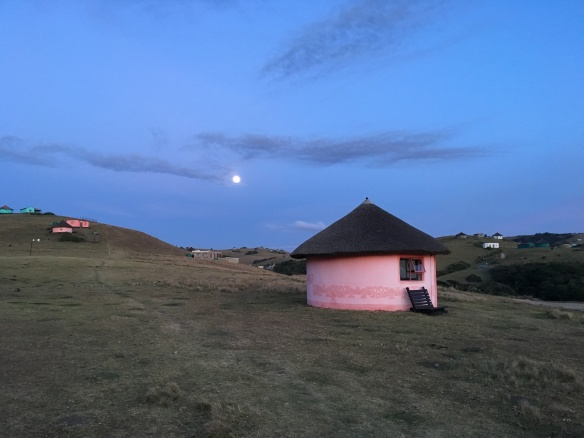 village hut and full moon